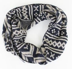 This scarf is FLYING out the door!  We love the classic sweater pattern motif - without having to commit to it on a whole sweater ;) Plus you can't beat Navy and Cream for a perfect chilly weather layering piece $28