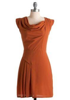 orange or rust dress with draped neck and dropwaist skirt