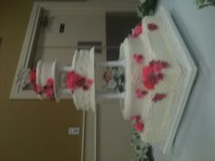 Four layer white buttercream cake with lace and shell details. Roses are gum paste.