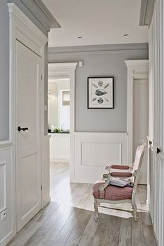 Light Grey Wall dark floors, soft grey wall colour, and white moulding..love it
