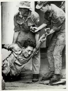 Viet Cong Weapons in Vietnam | Viet Cong terrorist is dragged from behind a building in the Gia ...