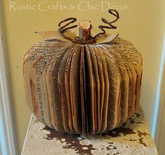 transform an old paperback book into a decorative pumpkin, crafts, The finished project with a birch stem burlap leaves bark covered wire and painted paper edges - maybe check DI for books. Fall Halloween, Halloween Crafts, Halloween Decorations, Autumn Decorations, Halloween Books, Fall Projects, Craft Projects, Craft Ideas, Project Ideas