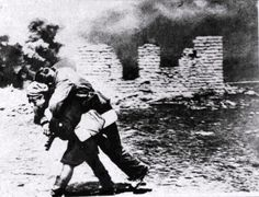 """""""Military nurse carries a wounded soldier Red Army, Stalingrad, 1942"""""""