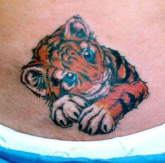 Google Image Result for http://inkarttattoos.com/wp-content/uploads/2009/12/cute-baby-tiger-tattoo.jpg