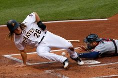 Jaso Scores:     Pittsburgh Pirates' John Jaso knocks the ball out of the glove of Atlanta Braves catcher A.J. Pierzynski to score on a fielder's choice in Pittsburgh, on May 17. The Pirates won 12-9.