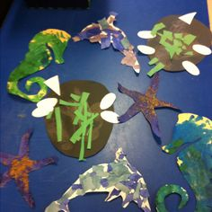 Sea creatures.... Sandy starfish Torn paper dolphins Salt+water painted sea horse Cut out turtle shells