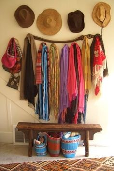 Use gum tree branch, bench (maybe industrial bench from kitchen), baskets underneath, hats on wall