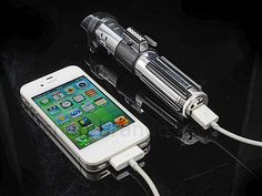 I have to get this. It charges your phone, it slices, it dices, capable of cutting through any object I give you Darth Vader's USB light saber iPhone charger