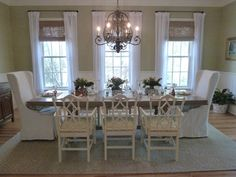 Such a pretty dining room.  I adore the bamboo style chairs w/ the pop of color fabic seats.