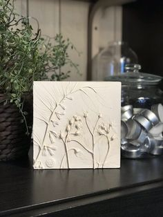 Flowers & plants clay wall relief by DinaArtDecor. Square botanical bas relief on stand. Farmhouse plaster tile for kitchen, hallway and mantel decorating. Flowers & plants botanical bas-relief for wall and table decor. The botanical panel is ideal for decorating the entrance hall, living room, kitchen, bedroom or baby room