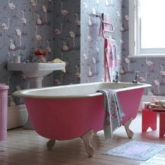 pink and grey bathroom w/ pink flamingos on the wall, and the cutest little tub you've ever seen
