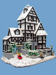 afol contest expands on the winter village. I love the use of 2 stud long technic beams as bricks.