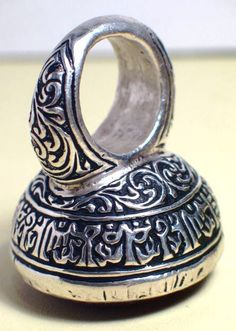Large and heavy silver ring from Iran engraved with a prayer all around the bezel. The ring is topped with a nice turqoise.