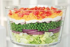 There's a reason this layered salad is classic: The flavors of red onions, peas, ham, mayo, Parmesan and tomatoes combine for a foolproof potluck winner.