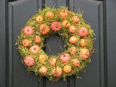 Pumpkins in moss wreath