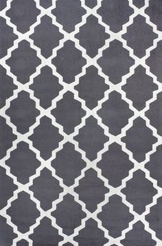 Cover up icky carpeting. If you have ugly wall-to-wall carpeting in your rental apartment, it can work wonders to layer fun area rugs on top. A solid natural-fiber rug or a crisp geometric print like this charcoal-gray and white version are foolproof choices.