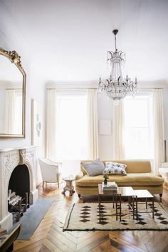 love the subtle glamour of this room in ornate fireplace and chandelier