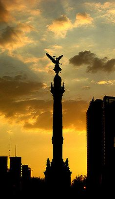 SERIES: REDISCOVERING MEXICO CITY A golden afternoon gives a striking end to a glorious day. This is the Angel of Independence sculpture at Reforma Avenue in Mexico City.
