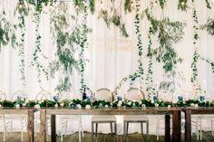 Disney-inspired wedding details - wedding quote on fabric wedding back drop + farm styled wedding table #weddingdetails #weddingdecor #weddingbackdrop #fabricdraped
