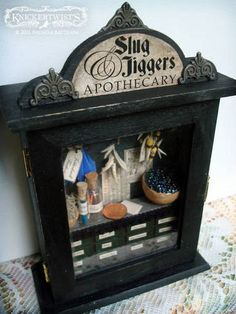 Slug & Jiggers Apothecary - kinda miniature shop from the HP world. Love the idea, other shops would be neat too! I'm picturing a tiny magical creatures shop!
