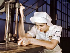 """August 1942. """"Women in white doctor Navy planes (motors) at the Naval Air Base, Corpus Christi, Texas. Mildred Webb, an National Youth Administration trainee at the base, is learning to operate a cutting machine in the Assembly and Repair Department."""" 4x5 Kodachrome transparency by Howard Hollem, Office of War Information. [Shorpy Historical Photo Archive :: Plane Doctor: 1942]"""