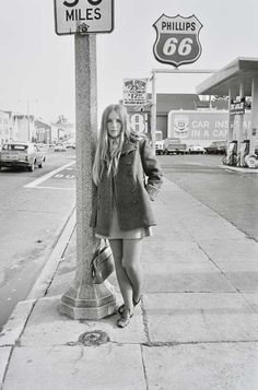 Untitled (Young girl next to Phillips 66 sign), 1960-1972 Gelatin Silver Print 20 x 16 inches