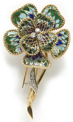 A plique-à-jour enamel and diamond flower brooch, French; hinged petals; with partial French assay mark; mounted in eighteen karat bicolor gold; length: 2 1/2in. Via Bonhams.