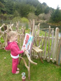 Outdoor painting - love the easel and fence - at Matapihi Kindergarten ≈≈
