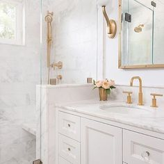 There is just something so pretty about white marble & brass fixtures, don't you think? Beautiful design by @amandaleereid. | @scoutandnimble Instagram