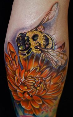 Awesome Large Flower And Bee Tattoo