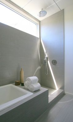 Bathroom, gray and white with shower and tub joined on one wall