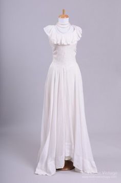Designed in the this seemingly hand crafted vintage wedding gown is done in a soft white cotton embroidered with an eyelet detail. The bodice features a scooped neckline with a ruffled collar, w Vintage Party Dresses, Vintage Outfits, Vintage Clothing, Vintage Gowns, 1940s Fashion, Vintage Fashion, Vintage Beauty, Vintage Style, Buy Wedding Dress Online
