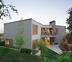 Concrete Croatian Residence Adorning a Steep Slope