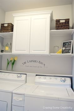 Farmhouse Laundry Room on a budget - less than $300 for everything and half of that is the cabinet. Grey and Yellow color scheme with multiple open shelves on either side of the cabinet