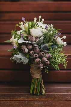 gumnuts in a grouped hand tied bouquet ... I would love only green eucalyptus leaves and green gumnuts in a nice, round, and full hand tied bouquet :)