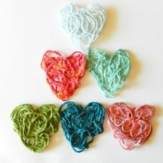 Make colorful valentines hearts with yarn scraps, cornstarch, and water.