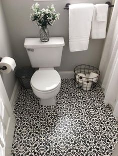 A farmhouse bathroom update by painting the FLOOR! This is a must see and find out what was used..........................