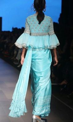 Sky blue chiffon saree with beautiful ruffle blouse. Saree Jacket Designs, Saree Tassels Designs, Saree Blouse Neck Designs, Fancy Blouse Designs, Saree Designs Party Wear, Designer Blouse Patterns, Designer Dresses, Stylish Blouse Design, Stylish Sarees