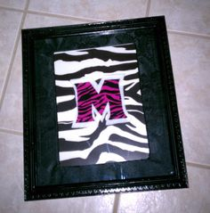 """Couldn't find the write type of pictures to hang in my daughter's zebra themed bathroom, so I made a few wall pictures...   Spray painted the plastic frame black, printed out a high res zebra print photo, cut out the letter """"M"""" (that's textured scrapbook paper) and traced the M a little bigger for the white felt behind the pink zebra print paper.  Was fun to make."""