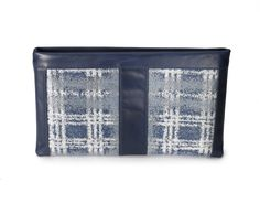 "Neelum Navy & Silver Italian Fabric with Italian Navy  Cow Leather Top Zip Clutch.  13"" x 7.75"" $340 Available at www.islyhandbags.com #clutchit #accessories #handbags #clutch"