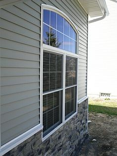 Wood blinds installed in a front window of a Toledo area home.