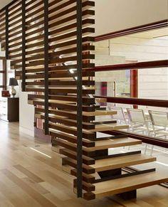 escalier en bois et acier à limon central et garde-corps de design moderne