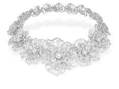 Chopard floral necklace with diamonds set in 18-karat white gold.