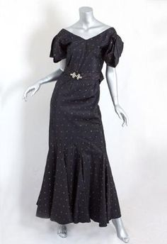 Black taffeta evening dress with embroidered bronze crescents, belt with rhinestone buckle, and bow at center back, 1930s. by rena