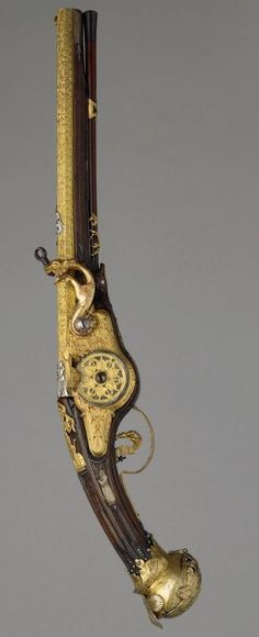 Wheel-lock pistol La FonteyneMonaco, France 1645 Copper alloy, gold, silver, steel, copper, antler, wood and horn, engraved and gilded. Wallace Collection.