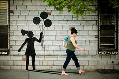 I just discovered the street art by Color Me Katie.  She is intent on reminding people of their child-like aspects, and making people feel less alone.