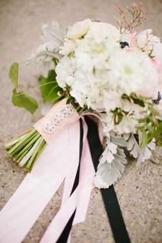 #bouquet-wrap    Read More: http://www.stylemepretty.com/2014/06/30/romantic-chicago-wedding-of-orange-is-the-new-black-star/