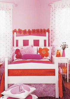 Pink Punch - Why stick with one set of bedding? Versatile white furniture can play second fiddle to any number of solids and patterns on the bed. Although once perfect for a baby nursery, the sweet pink walls get an instant facelift with hot pink and bold orange.