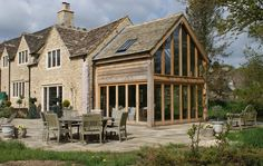 An oak wood and glass extension in Cirencester, Cotswolds. Chalet Extension, Cottage Extension, House Extension Design, Glass Extension, Extension Ideas, Cotswold House, Thatched House, Oak Framed Extensions, House Extensions