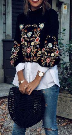 black embroidered top. white blouse. denim.